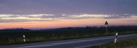 Sunset Over Federal Road Royalty Free Stock Photo