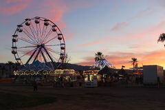 Sunset over Ferris Wheel and Carnival Rides. Sunset captured over a Ferris Wheel and Carnival Rides Lake Havasu Balloon Festival Royalty Free Stock Photos
