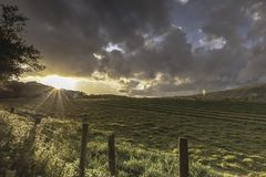 Sunset over field and dramatic sky in Lake District,Cumbria,Uk. Tranquil scenery of british countryside in late summer.Idyllic rural landscape.Beauty in nature royalty free stock photography