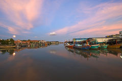 Sunset over fishing boat at  habour, Thailan Royalty Free Stock Images