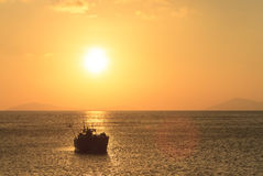 Sunset over fishing boat Stock Photography
