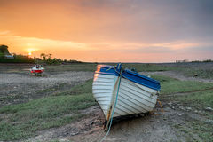 Sunset over Fishing Boat at Porlock Weir. An old wooden fishing boat at sunset on Porlock Weir on the the Somerset coast on Exmoor National Park stock photos