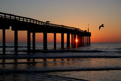 Sunset over fishing pier Royalty Free Stock Images