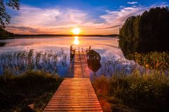 Sunset over the fishing pier at the lake in Finland royalty free stock photography