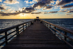 Sunset over the fishing pier in Naples, Florida. Stock Images