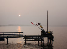 Sunset over a fishing pier in a small village Rewa on the Polish Baltic coastline. Stock Photos
