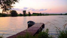 Sunset over fishing pond. Purple sunset over fishing pond in summer. Timelapse stock video