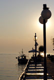 Sunset Over Fishing Village In Greece Royalty Free Stock Photos
