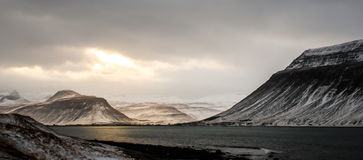 Sunset over the fjord. Sun, setting over the fjord in western Iceland, winter stock photography