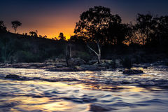 Sunset over the flooding river Stock Photography