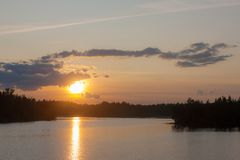 Sunset over a forest lake Royalty Free Stock Photography