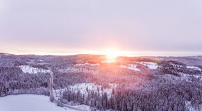 Sunset over forests in hillside in winter Royalty Free Stock Photo
