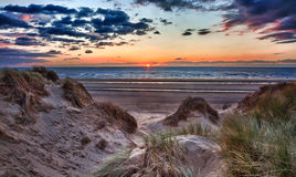 Sunset over Formby Beach through dunes Royalty Free Stock Photo
