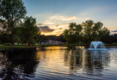 Sunset over fountain pond in Luray, Virginia. Stock Images