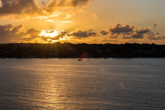 Sunset over Frederiksted in the Virgin Islands with natural lens. Flare Stock Photos