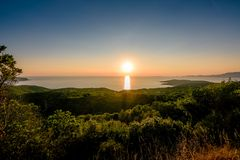Sunset over the French coast of Corsica. stock photography