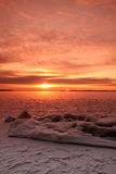 Sunset over frozen lake Stock Photos