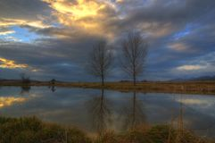 Sunset over the frozen lake - picture during early winter royalty free stock photos