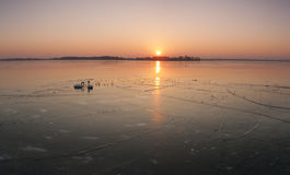Sunset over the the frozen lake Stock Photo