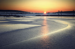 Sunset over a frozen lake at sunset Royalty Free Stock Photography