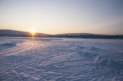 Sunset over frozen lake Stock Photography