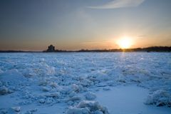 Sunset over frozen river Stock Photography