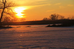 Sunset over the frozen river Dnieper Royalty Free Stock Photos