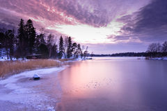 Sunset over frozen sea Stock Photo
