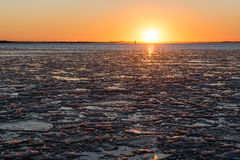 Sunset over frozen sea Stock Image