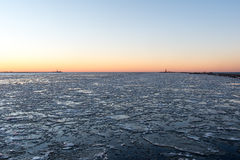 Sunset over frozen sea Royalty Free Stock Photos