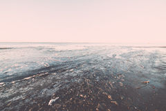 Sunset over frozen sea - vintage retro effect Stock Photography