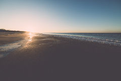 Sunset over frozen sea - vintage retro effect Royalty Free Stock Photography