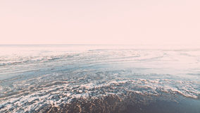 Sunset over frozen sea - vintage retro effect Royalty Free Stock Images