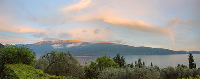 Sunset over garda lake, view to monte baldo mass Royalty Free Stock Image