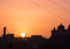 Sunset over Ghoortan citadel by village near Varzaneh in Iran Stock Photography
