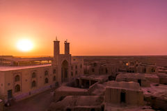 Sunset over Ghoortan mosque in Iran royalty free stock image