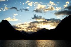 Sunset Over Glacier National Park. Sunset photo over the mountains of east Glacier National Park near the Two Medicine Campground Stock Image