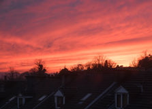 Sunset Over Glasgow Rooftops. Dramatic Pink Sunset Over Terrace House Rooftops In Glasgow Scotland Royalty Free Stock Images
