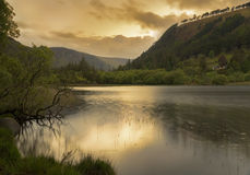 Sunset over Glendalough lower lake, ireland Royalty Free Stock Photo