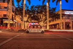 Sunset over the glittering white lights around The Naples Playe royalty free stock photos