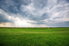 Sunset over the golf course, luxury green field at the golf club Stock Photo