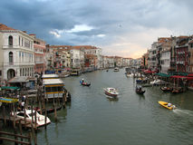 Sunset over Grand Canal. Scenic view of sunset and cloudscape over Grand Canal, Venice, Veneto, Italy Royalty Free Stock Photo