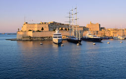 Sunset over the Grand Harbour - Malta. Sunset over the fort St. Angelo in the Grand Harbour of Malta Royalty Free Stock Photo