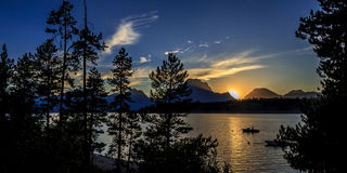 Sunset over the Grand Tetons. And reflections on Jackson Lake, Wyoming Royalty Free Stock Photos