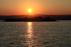 Sunset over a greek island in the Mediterranean sea Stock Images