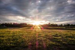 Sunset over green farm Stock Image