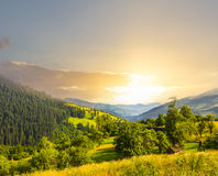 Sunset over a green mountain valley Stock Photo