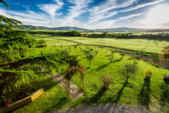 Sunset over the green valley in Tuscany Royalty Free Stock Image