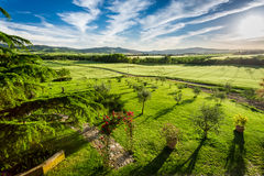 Sunset over the green valley in Tuscany Royalty Free Stock Photos