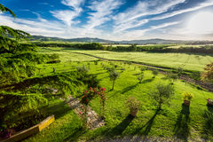 Sunset over the green valley in Tuscany Stock Images